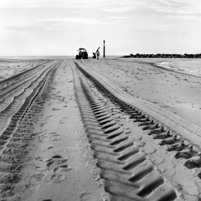 """Tractor tyre marks in the sand at Sea Palling, Norfolk"" stock image"