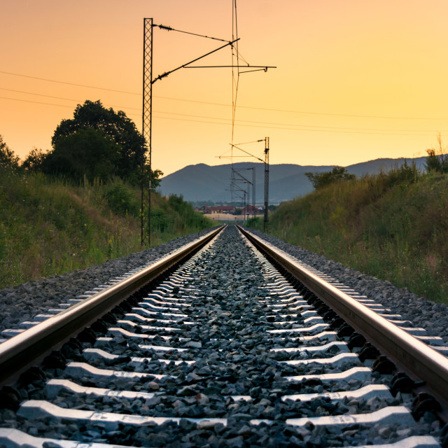 """Vintage empty railroad at sunset time"" stock image"