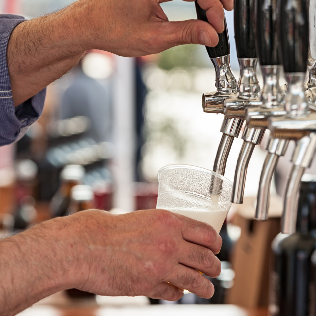 """Pouring fresh beer"" stock image"