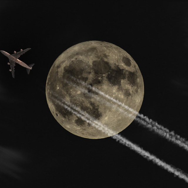 """""""Jet Flying Under a Full Moon at Night"""" stock image"""