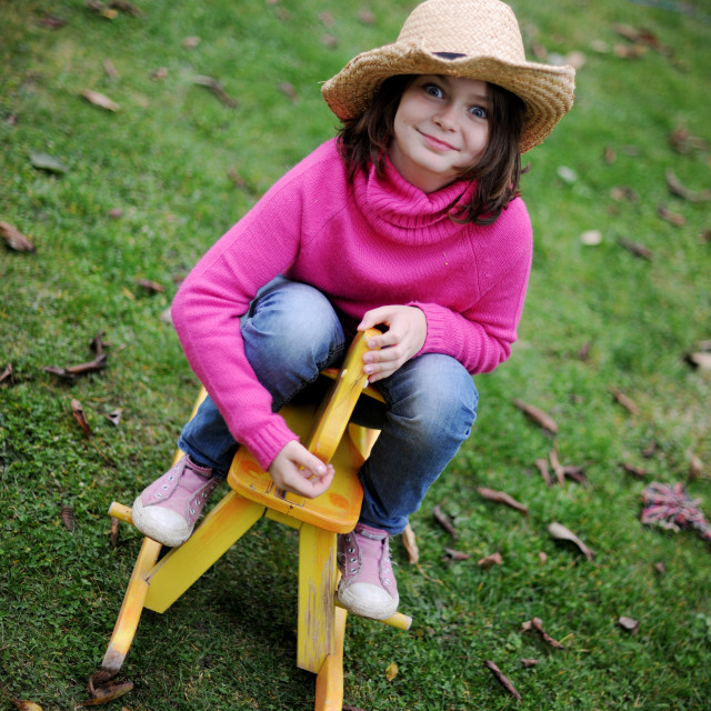 """""""Girl is Playing Cowgirl"""" stock image"""