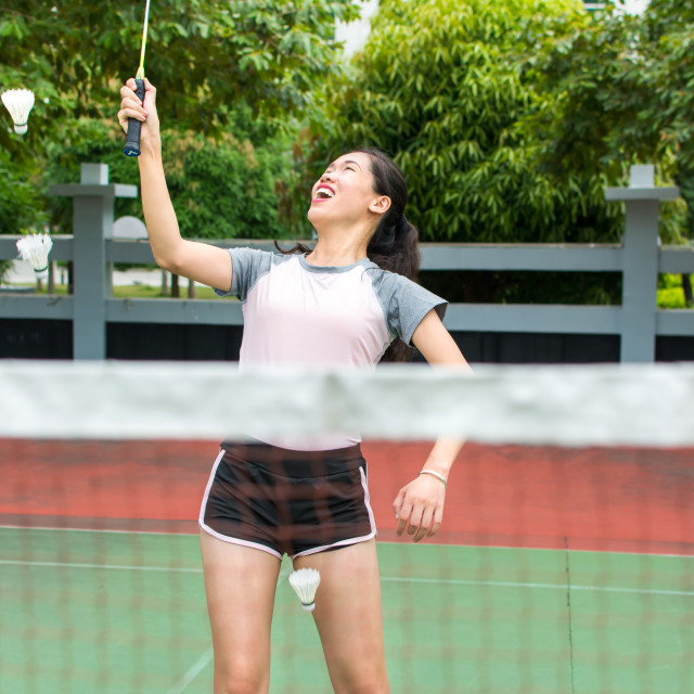 """""""Asian girl playing badminton on the court"""" stock image"""
