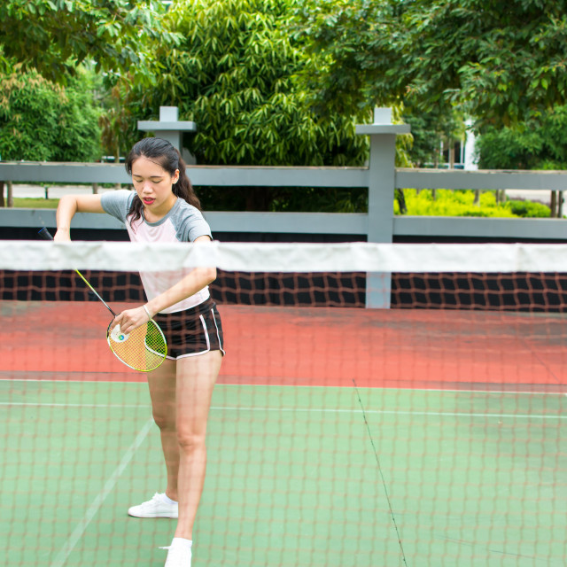 """""""Girl serving on a badminton match outdoors"""" stock image"""