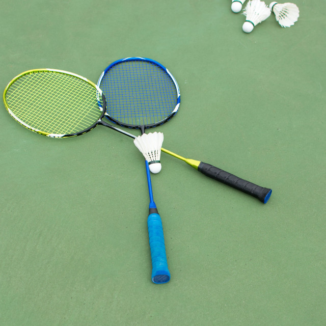 """""""Badminton balls and paddles on a court"""" stock image"""