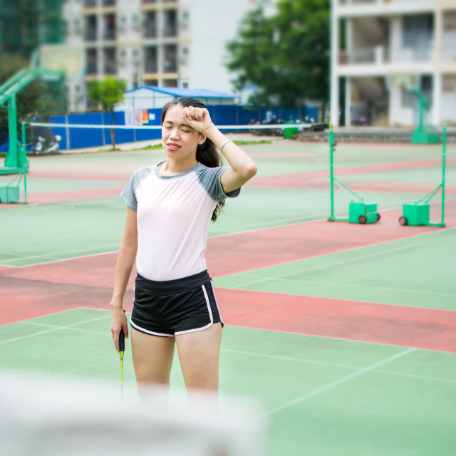 """""""Badminton player wiping sweat on the court"""" stock image"""