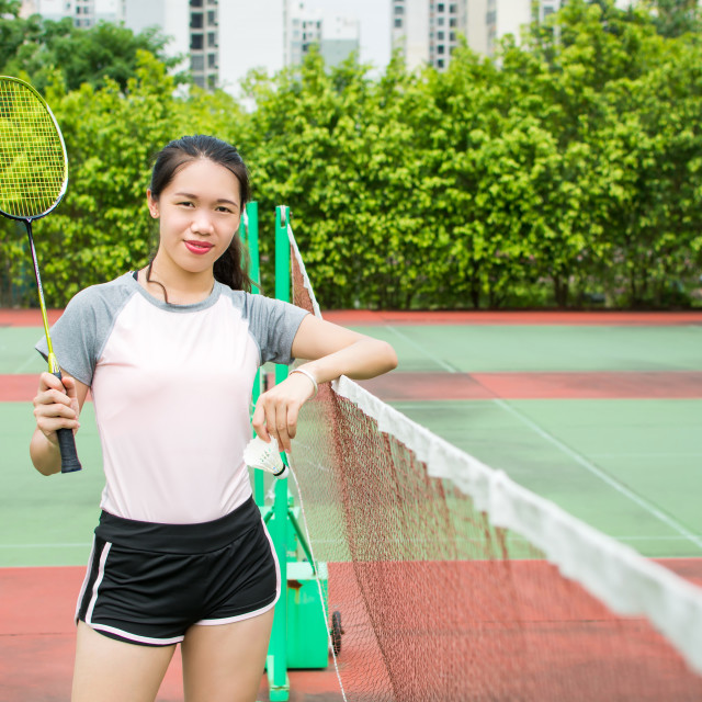 """Asian girl standing on the badminton court"" stock image"