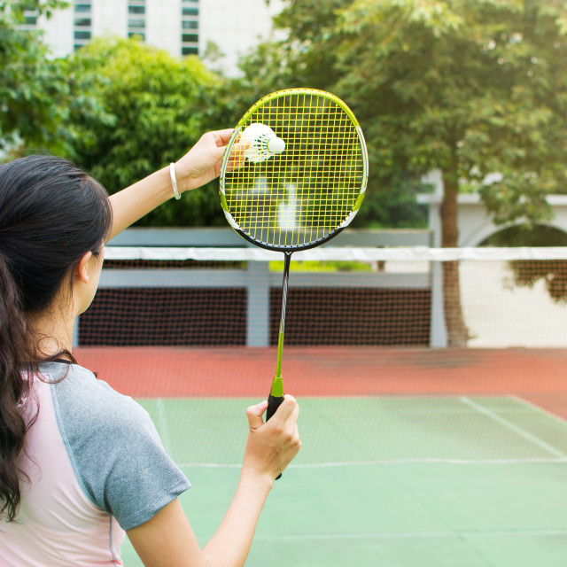 """Girl serving on a badminton match outdoors"" stock image"