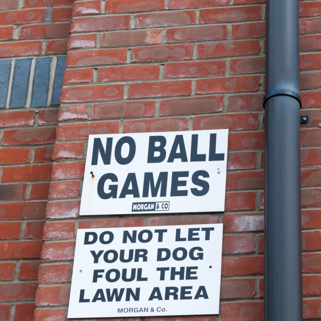 """""""a sign outside up on the wall white and black saying no balls games do not..."""" stock image"""