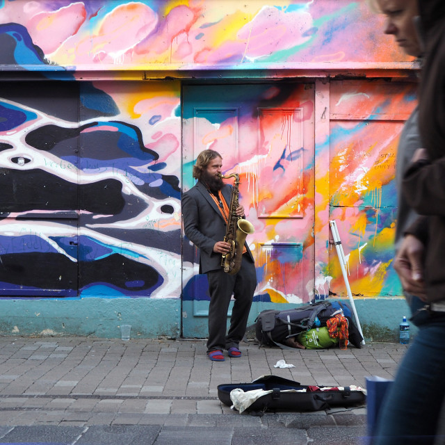 """Street musician, Galway City, Ireland"" stock image"