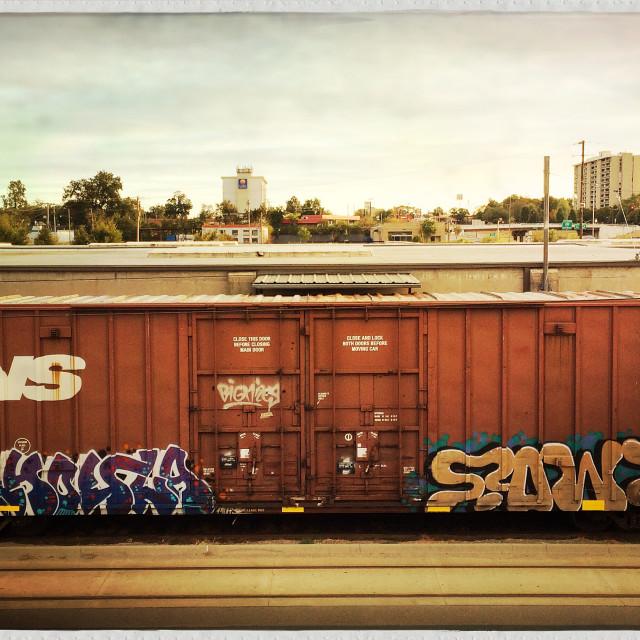 """Panoramic shot of graffiti covered train boxcar in Little Rock Arkansas"" stock image"