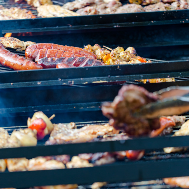 """BBQ large grill with roasted meat, stew, sousages, chicken breas"" stock image"