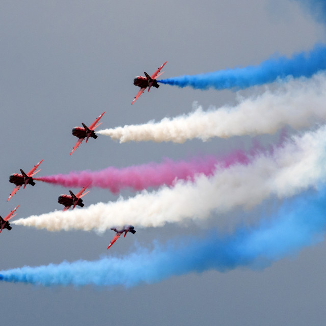 """RAF Red Arrows and a trail of colour"" stock image"