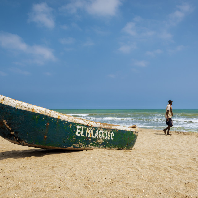 """Palomino, Colombia - March 13, 2014: Man walking in the Palomino Beach in the Caribbean Coast of Colombia, South America"" stock image"