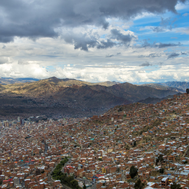 """The city of La Paz seen from El Alto and the surrounding mountains on the background, in Bolivia, South America"" stock image"