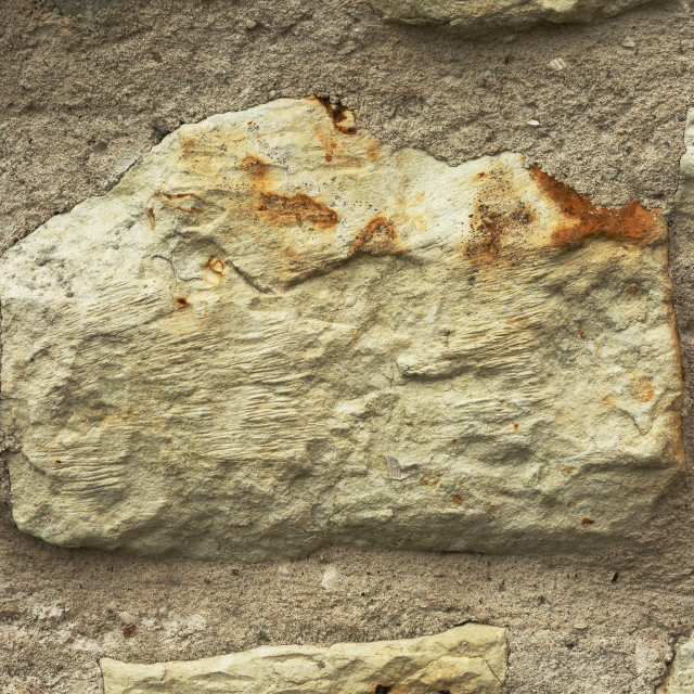"""Close view on big stone in old wall ,interesting background"" stock image"