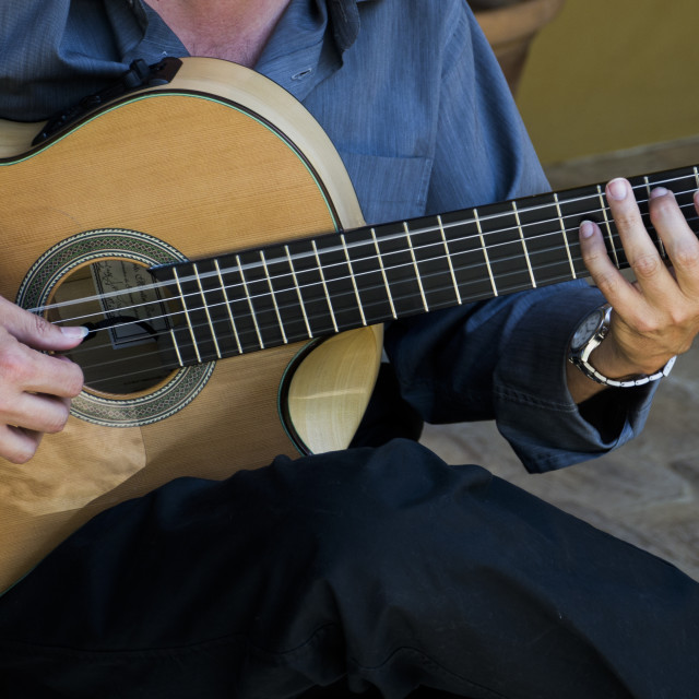 """Acoustic Guitar being played"" stock image"