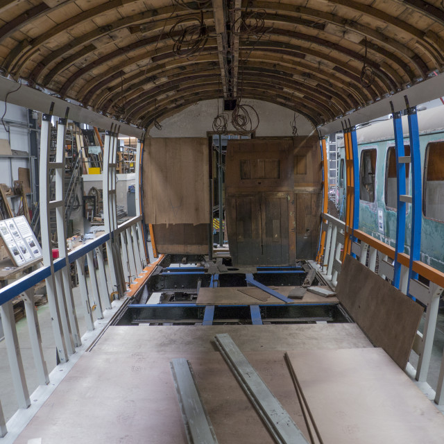"""Interior of vintage railway carriage under restoration"" stock image"