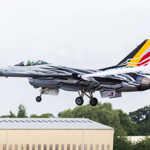 """""""Belgian F-16 Demonstration """"Blizzard"""" arrives in style at the Air Tattoo"""" stock image"""