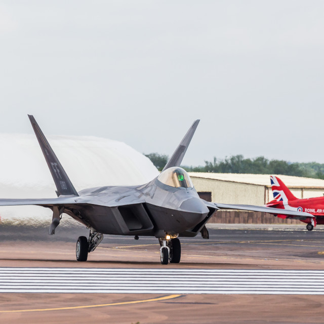 """F-22 Raptor taxis out onto the runway"" stock image"