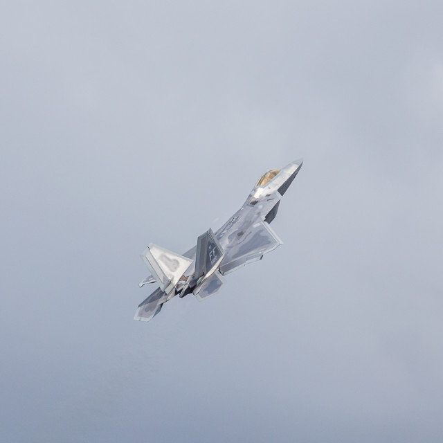 """F-22 Raptor in the moody skies at RIAT17"" stock image"