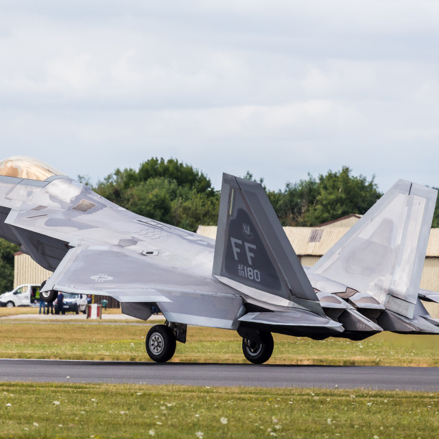 """F-22 Raptor decelerates after landing"" stock image"