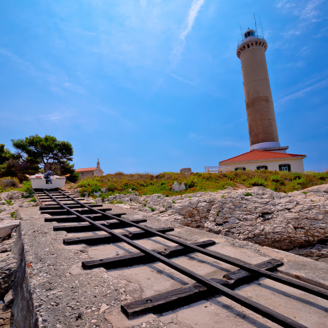 """Veli Rat lighthouse and boat extraction tracks"" stock image"