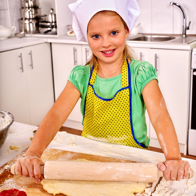 """Child knead dough at kitchen."" stock image"