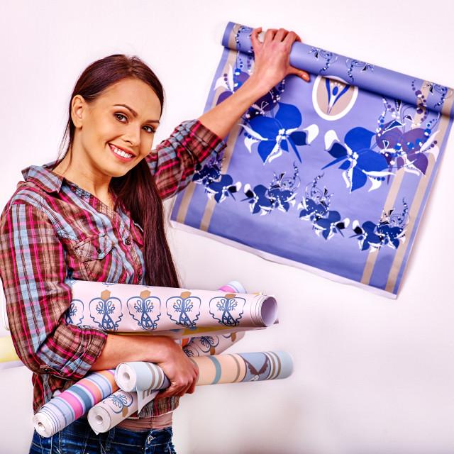 """Happy woman glues wallpaper ."" stock image"