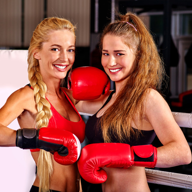 """""""Portrait of two sport girl boxing on ring."""" stock image"""