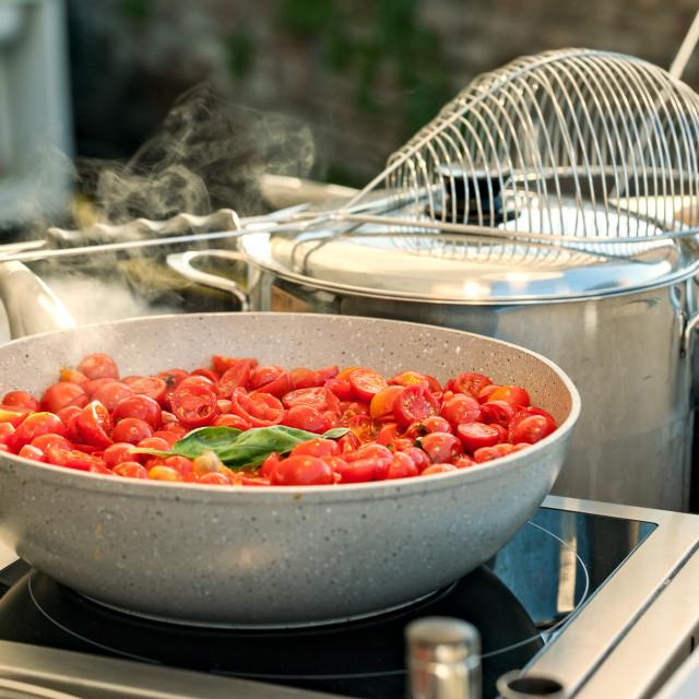 """Cherry tomatoes on a saucepan"" stock image"