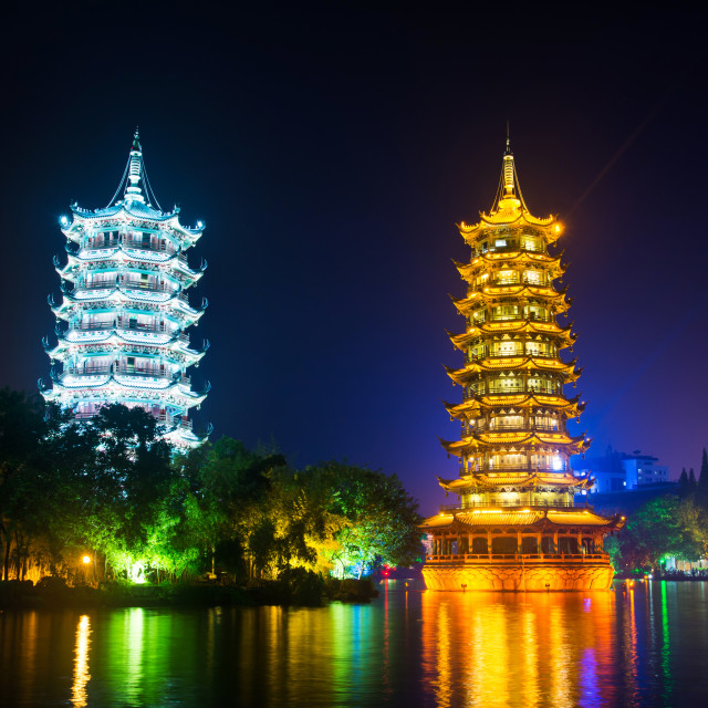"""Guilin towers in illuminated city park in Guangxi, China"" stock image"