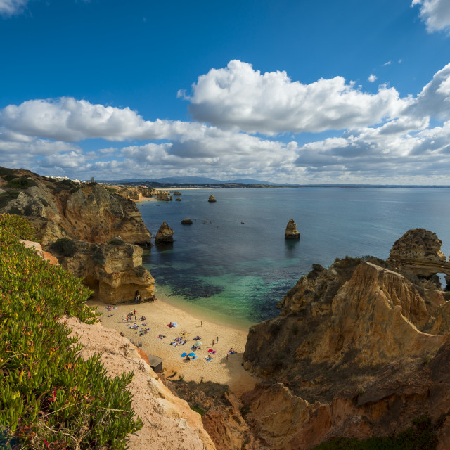 """Praia do Camilo, Portugal - July 6, 2017: People at the beautiful Camilo Beach (Praia do Camilo) and the surrounding cliffs in Lagos, Portugal"" stock image"