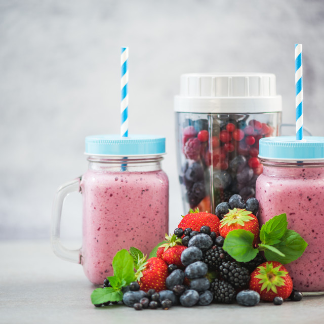 """Homemade berry smoothie in jars and blender"" stock image"