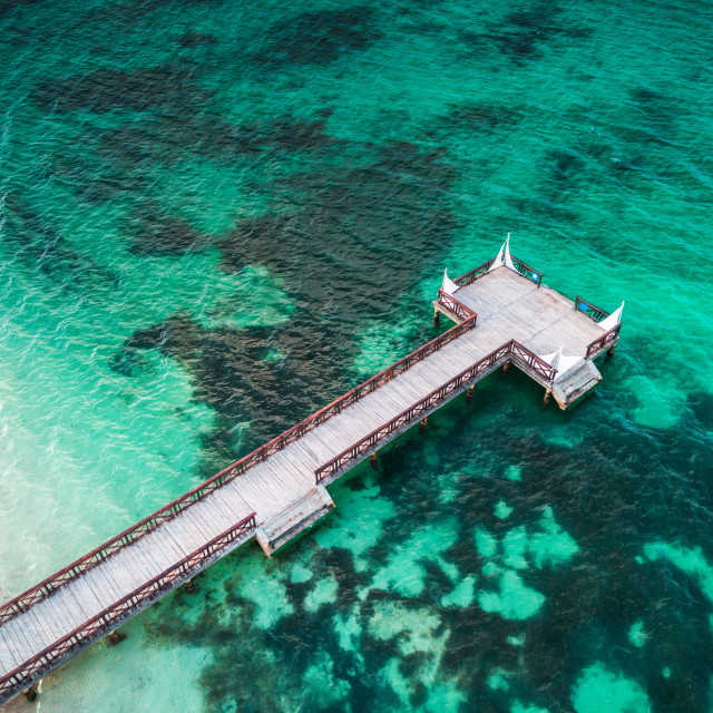 """Aerial view of tropical wooden pier and turquoise caribbean sea"" stock image"
