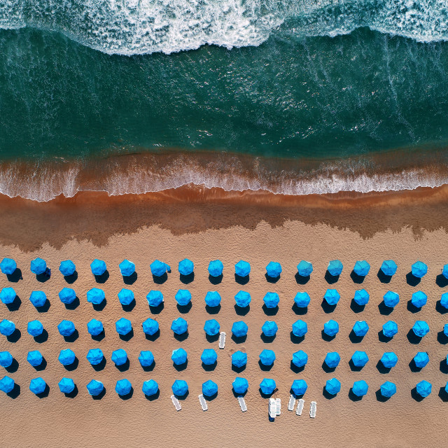 """Aerial top view on the beach. Umbrellas, sand and sea waves"" stock image"