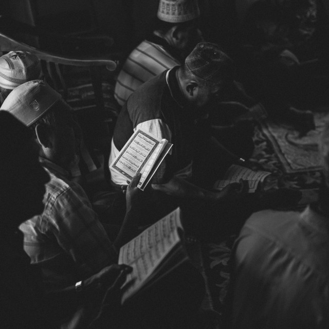 """Black & White - Muslim Men reciting/reading the Quran."" stock image"