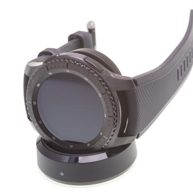 """Smart watch on charging dock"" stock image"