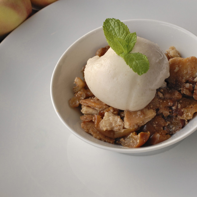 """Peach Crumble and ice cream"" stock image"