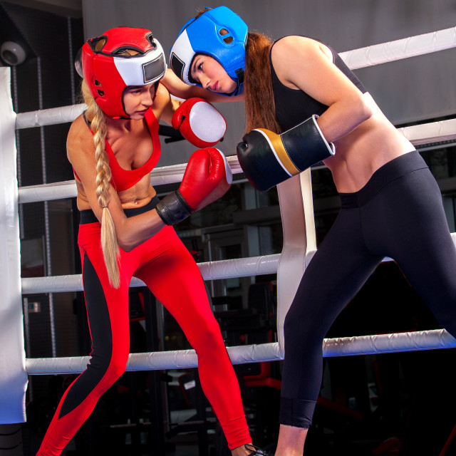 """Two boxing women workout in fitness class ring."" stock image"
