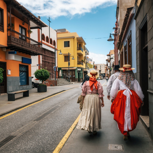 """Locals in Canarian traditional clothes walk along the street of Puerto de la Cruz. Day of Canary Islands. Tenerife."" stock image"