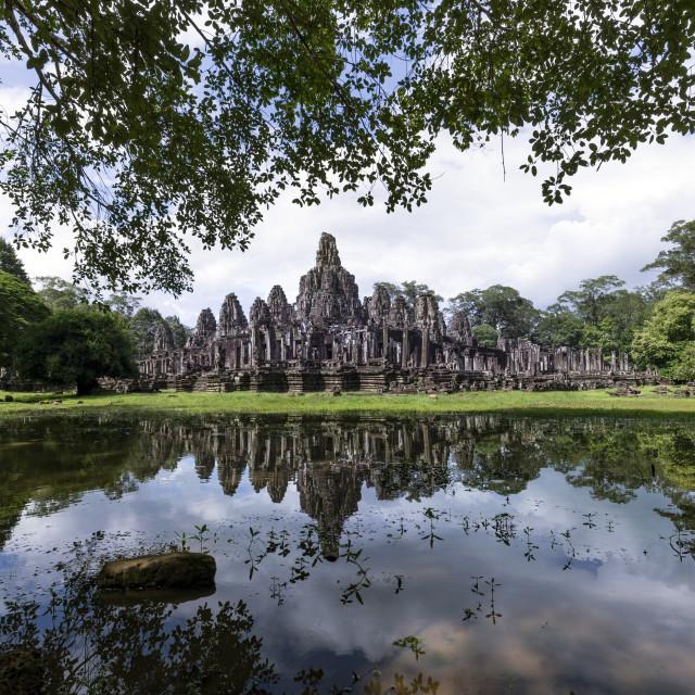"""Angkor Wat with reflection on water at morning, Cambodia"" stock image"