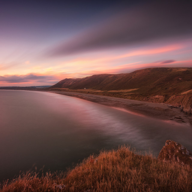 """Sunset at Rhossili Bay, South Wales"" stock image"