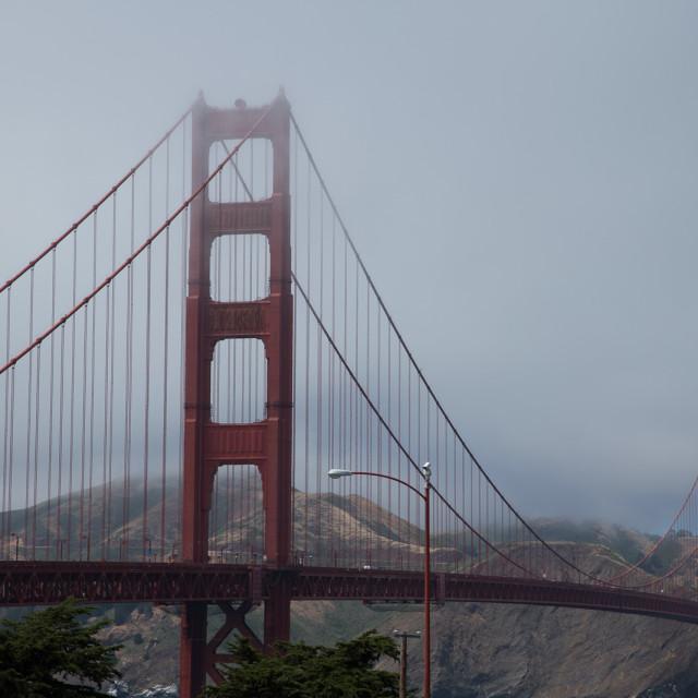 """Golden Gate bridge shrouded in fog"" stock image"