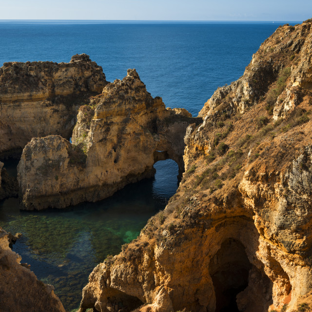 """""""Small bay between the sandstone cliffs at the Ponta da Piedade in Lagos, Portugal"""" stock image"""
