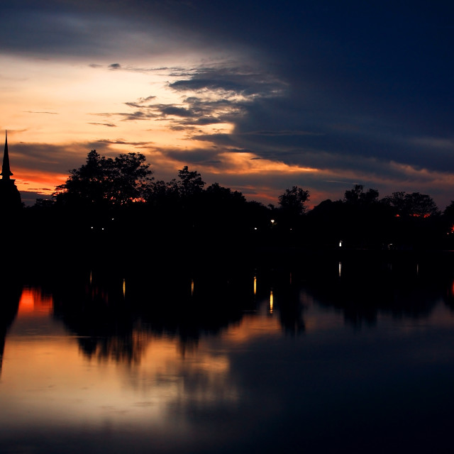 """19986669 - silhouette scene of pagoda at twilight or dusk in sukhothai historical park, thailand"" stock image"