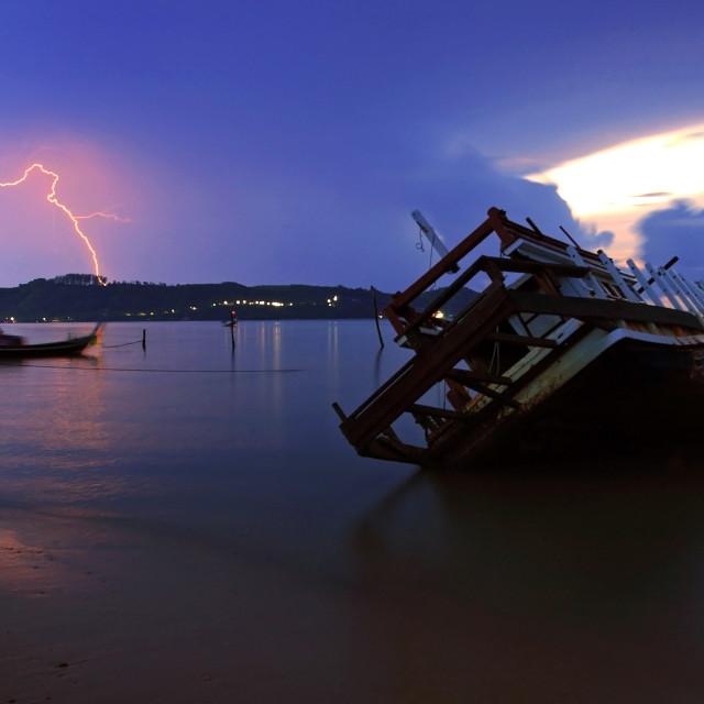 """shipwreck and Lightning at dawn in Phuket"" stock image"