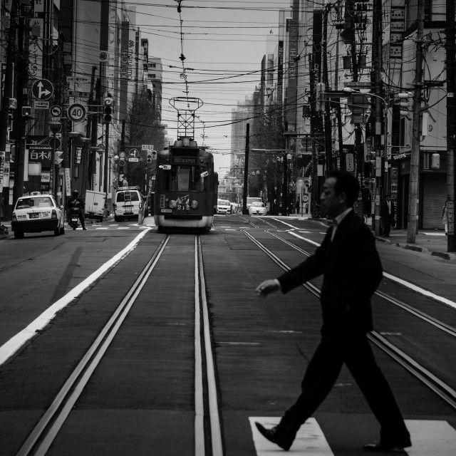"""""""man cross street while tram is riding"""" stock image"""