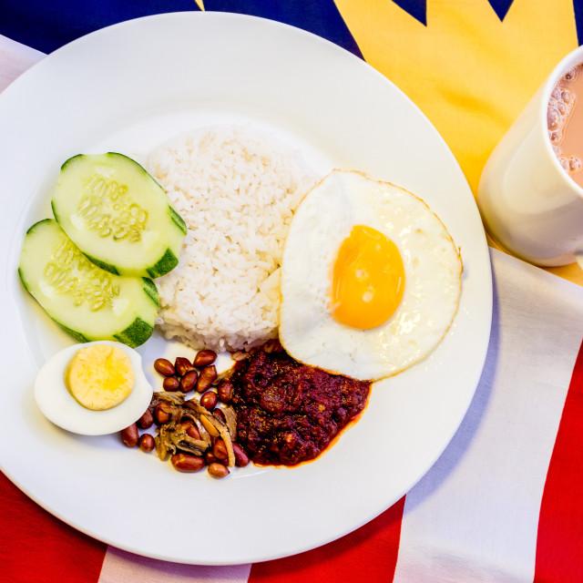 """Malaysian Breakfast - Nasi Lemak and Teh Tarik on Malaysia Flag."" stock image"