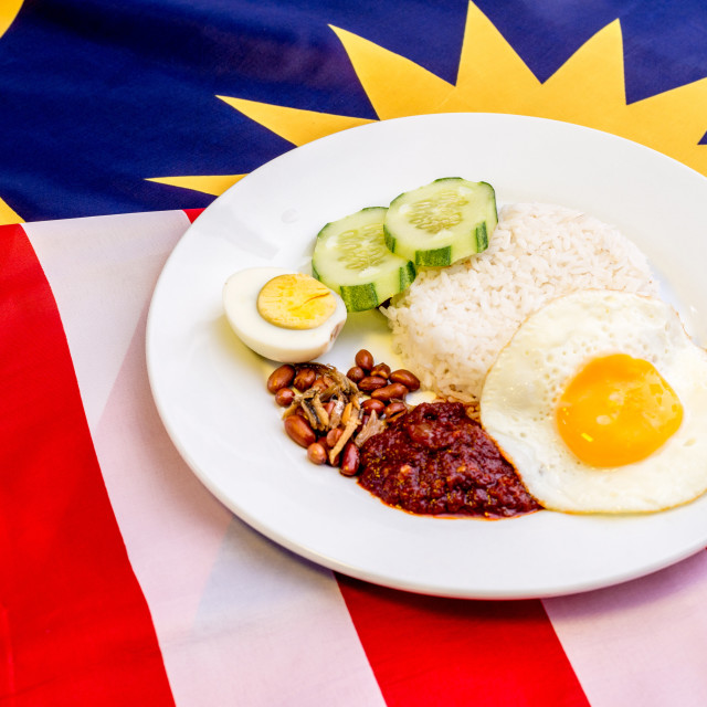 """Malaysian Breakfast - Nasi Lemak on Malaysia Flag. It is unoffic"" stock image"