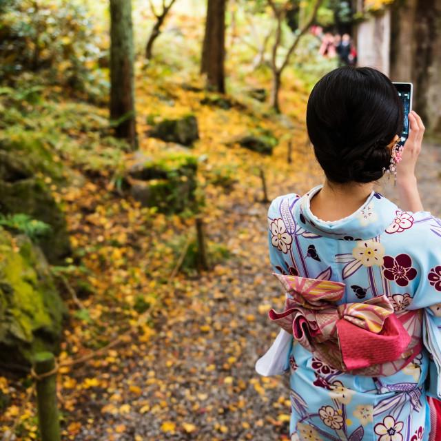 """Kimono girl selfie by smartphone"" stock image"